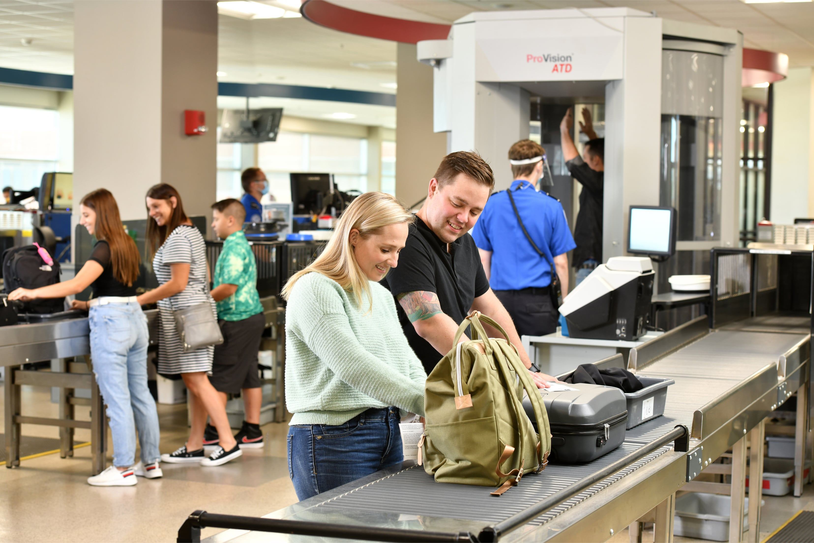 Couple going through TSA security at Des Moines International Airport