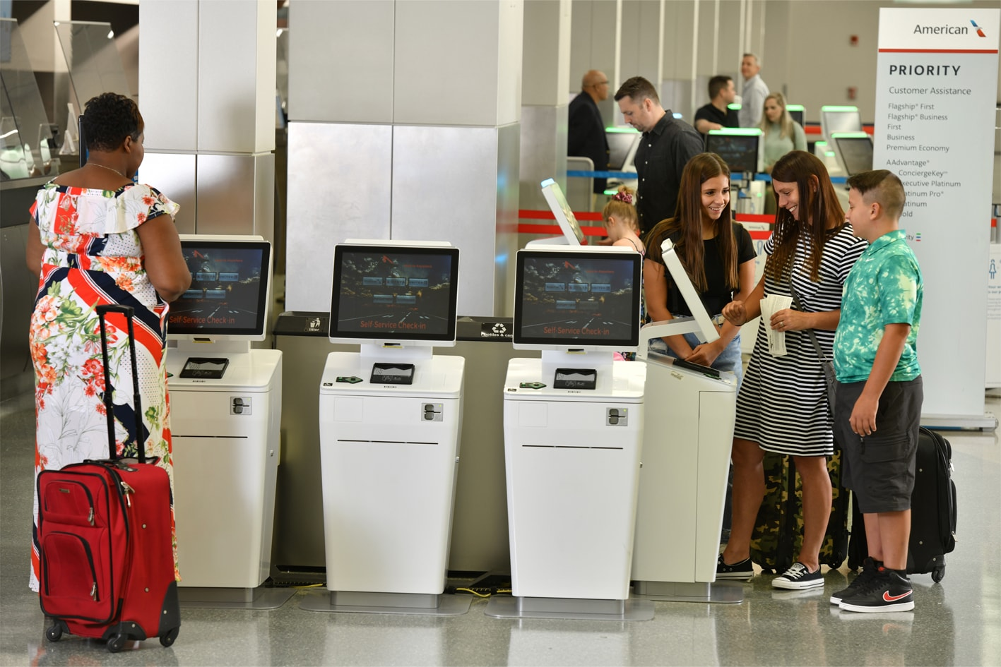 Family using ticket kiosks Des Moines International Airport